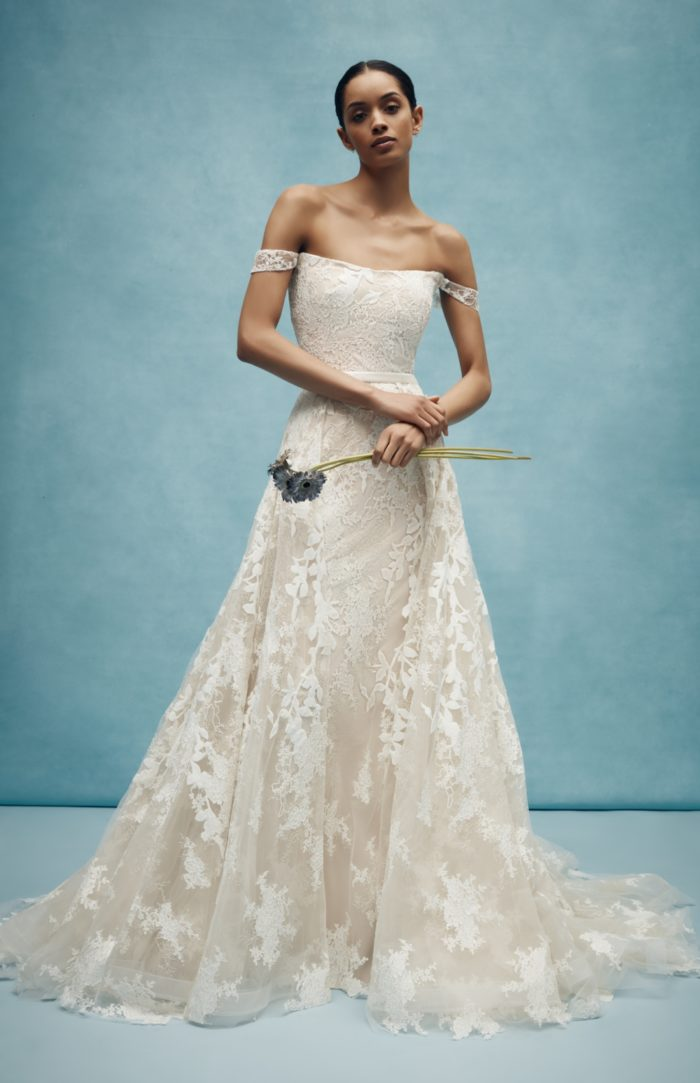 Ivory lace wedding dress with overskirt by Anne Barge