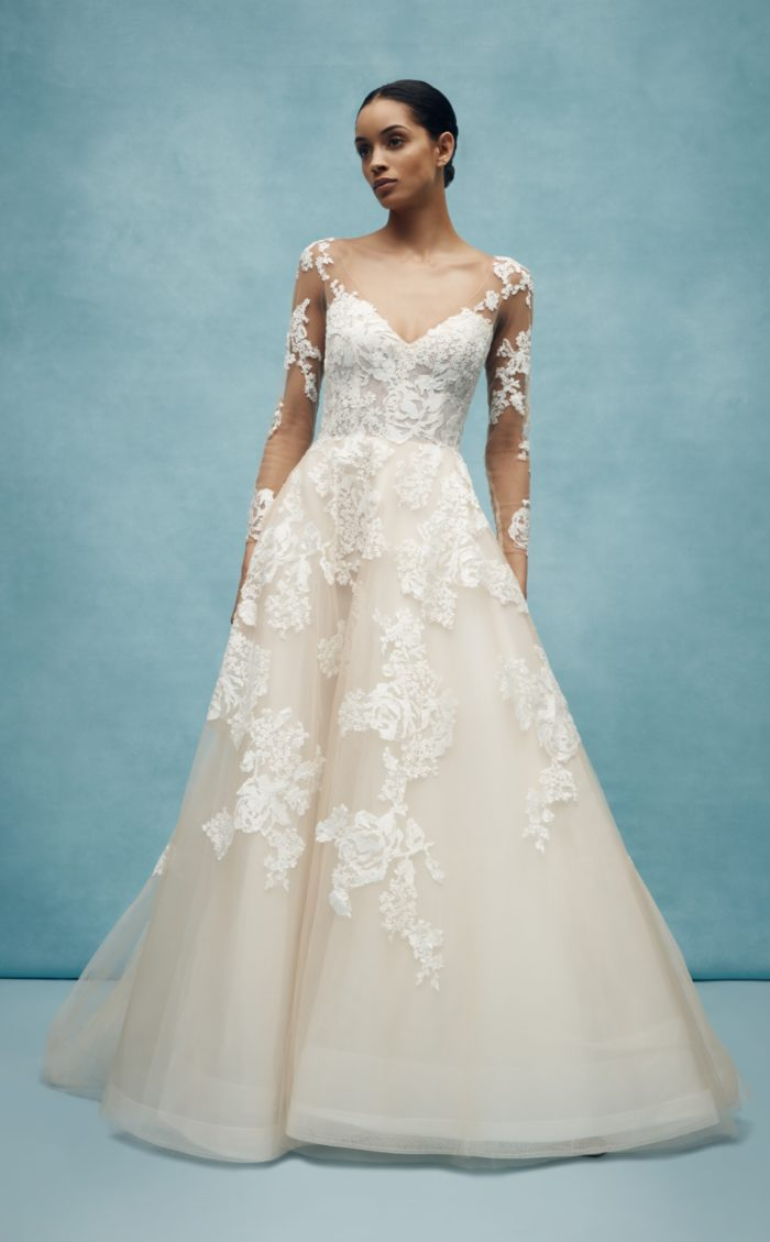 Long sleeve wedding dress with tulle skirt