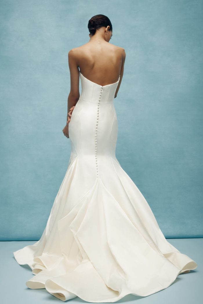 Sleek strapless wedding dress with buttons up the back