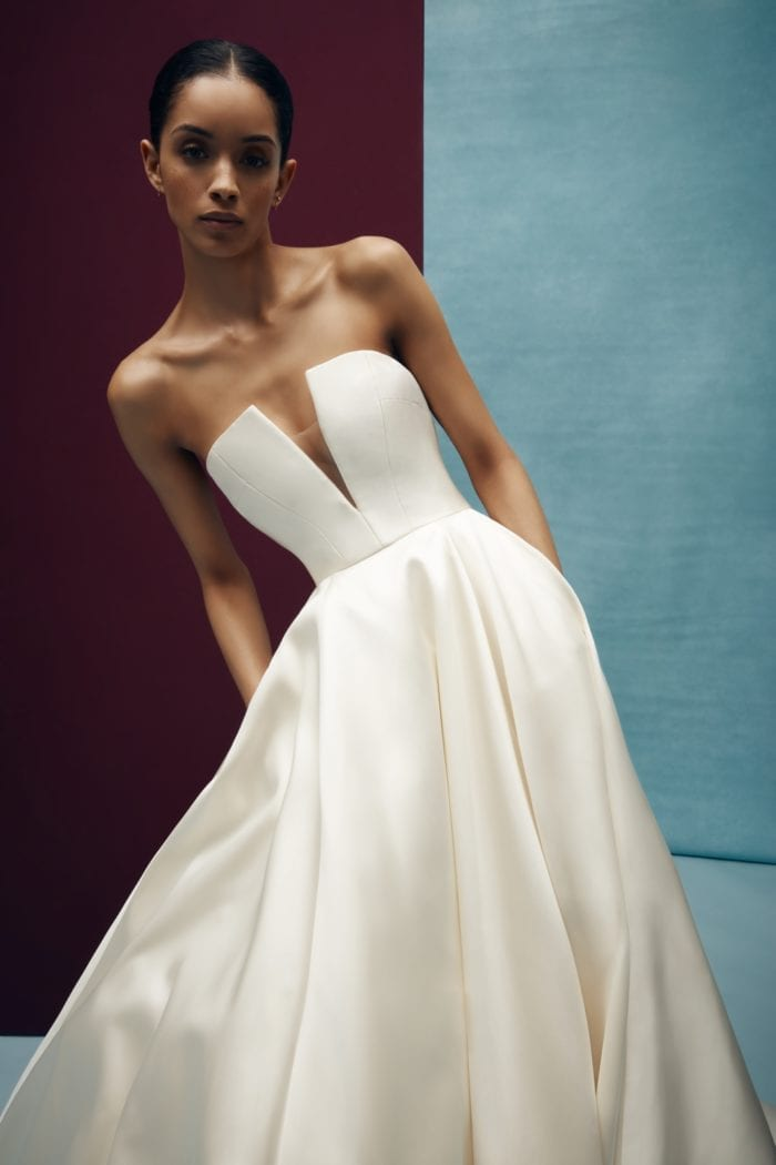 Strapless ivory wedding dress with ball gown skirt and pockets