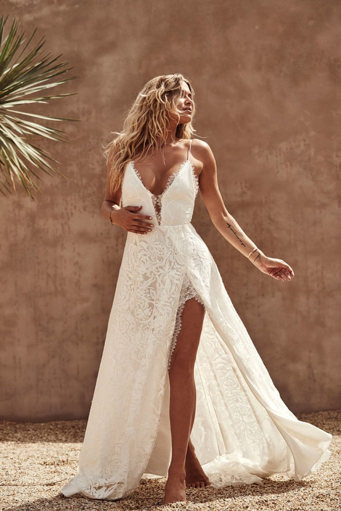 Sexy lace plunge neck spaghetti strap bridal gown with leg slit