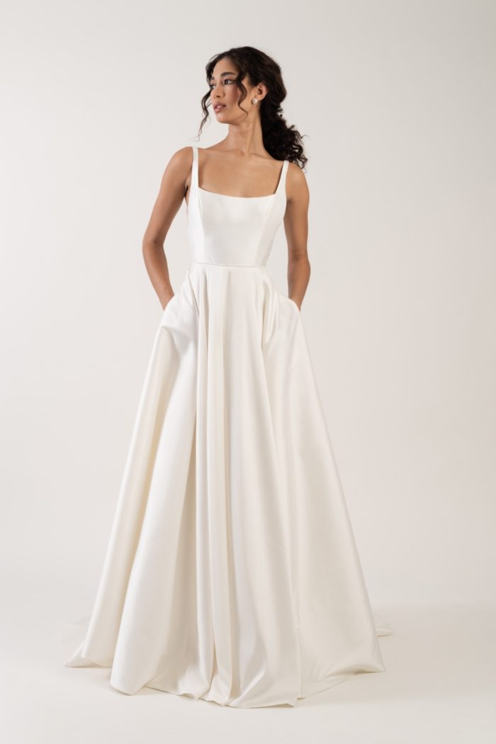 Scoop neck style wedding gown with pockets