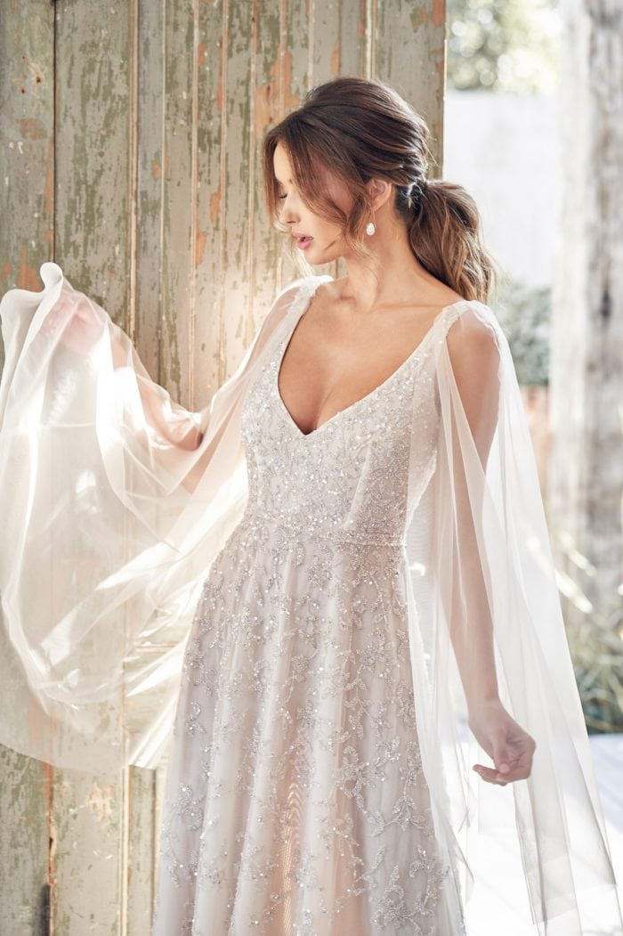 Sheer Bishop Sleeves over crystal beaded bridal gown