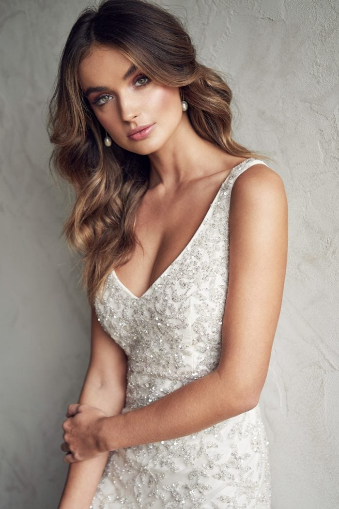 Fitted beaded wedding dres with deep v neck