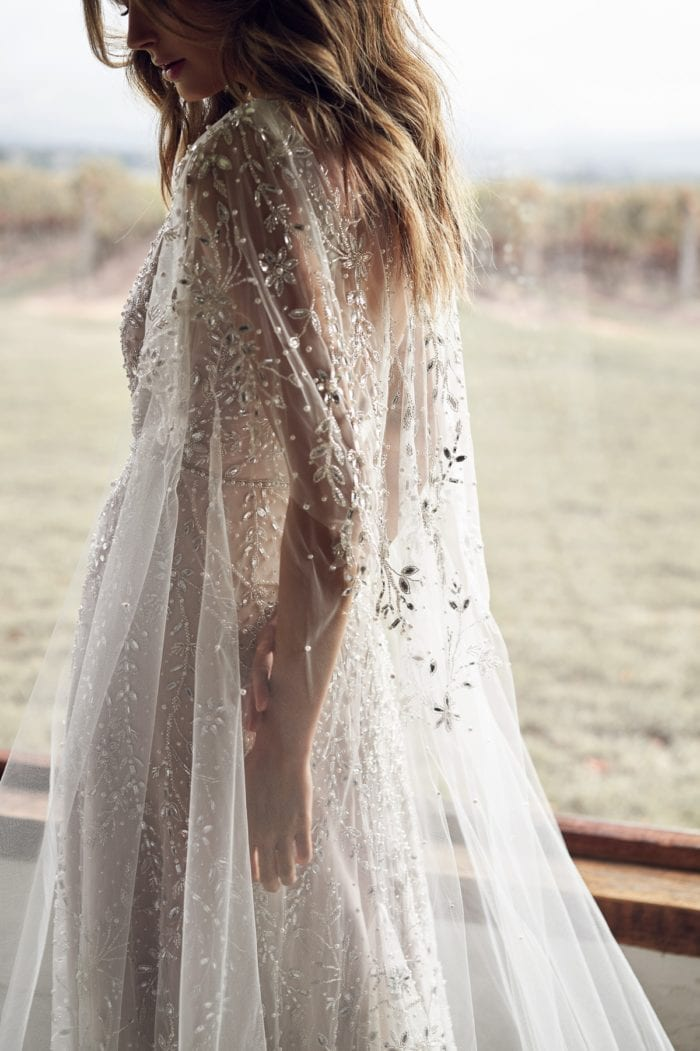 Beaded cape bridal gown