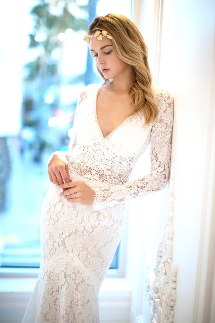 Long sleeve lace wedding dress with v neck by Winnie Couture