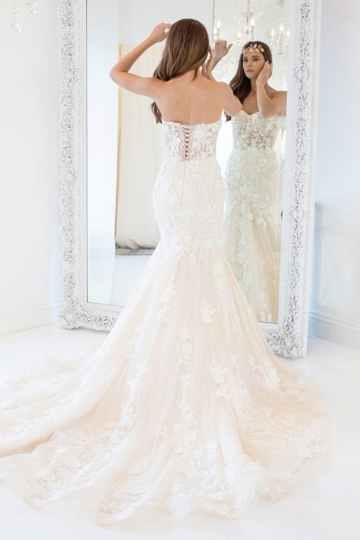 Strapless laced bodice bridal gown