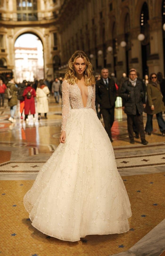 Long sleeve full skirt bridal gown