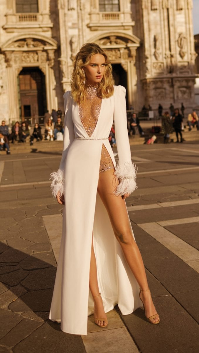 Long sleeve wedding dress with thigh high slit