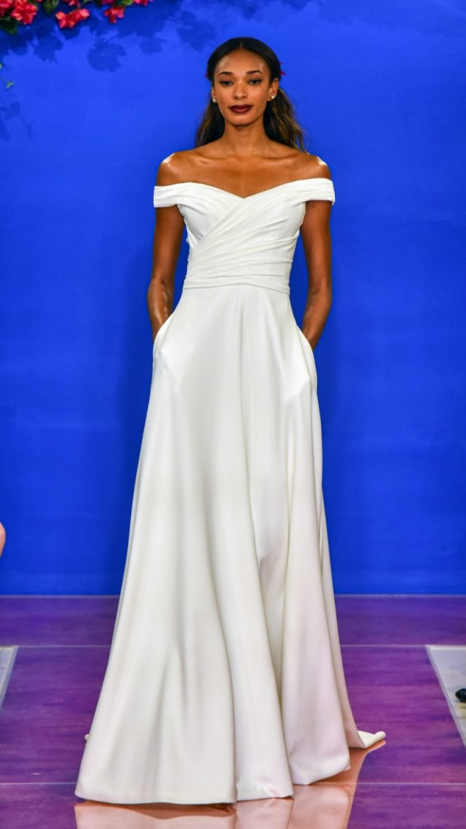 off-the-shoulder crepe wedding gown with draped bodice