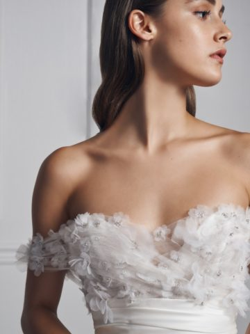 Detail of off-the-shoulder wedding dress with floral applique