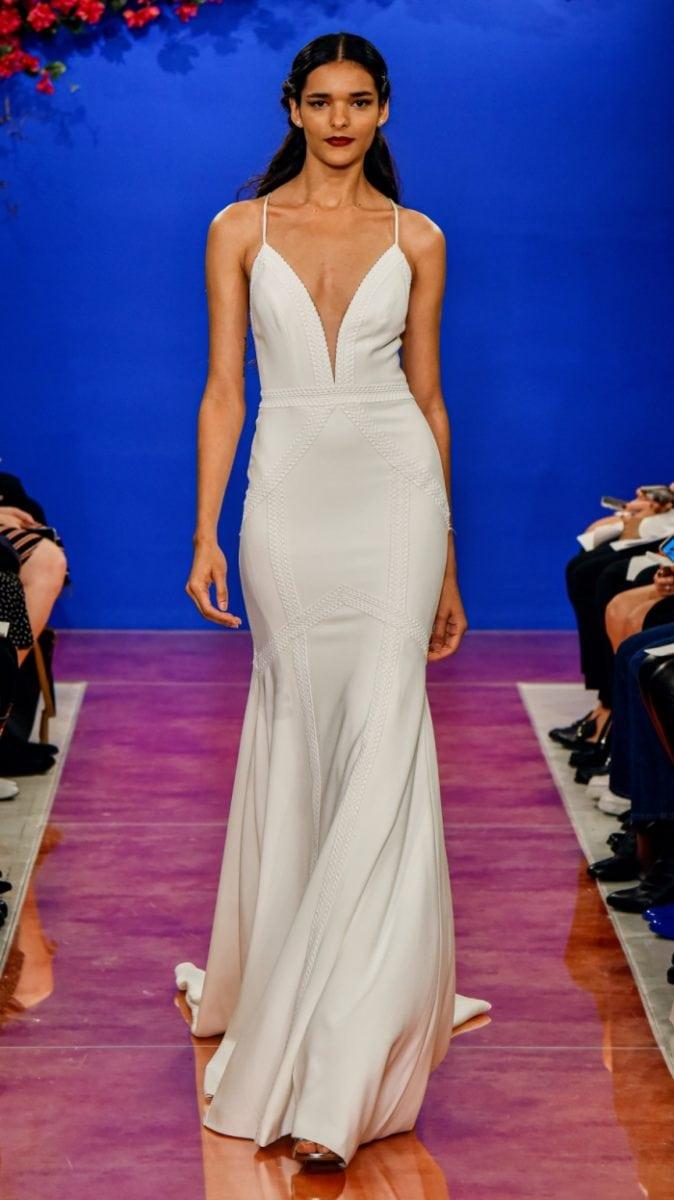 Plunge neckline spaghetti strap wedding dress