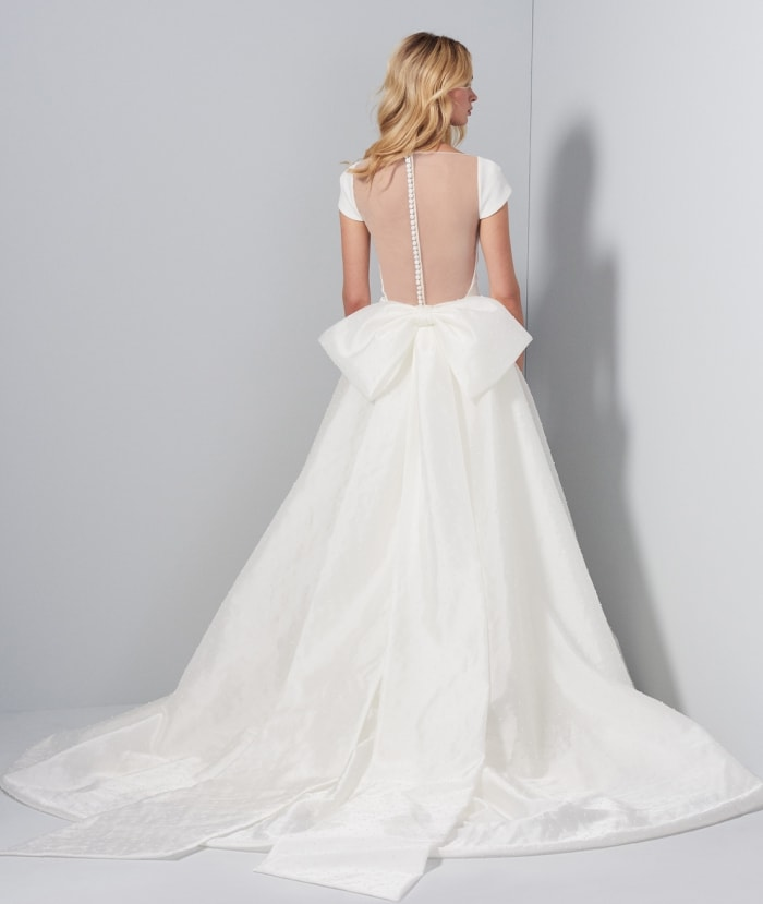 Back detail of Aimee Gown with bow overskirt