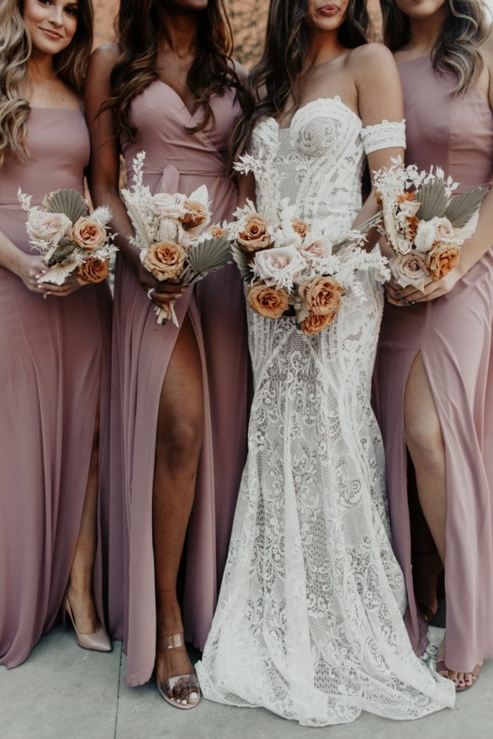 Flowers and Mauve Dresses for Bridesmaids from Dessy