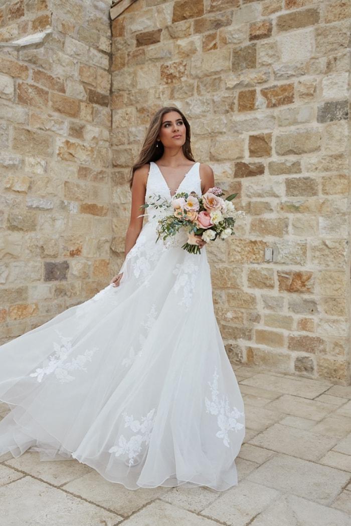 Floaty wedding dress with V neck