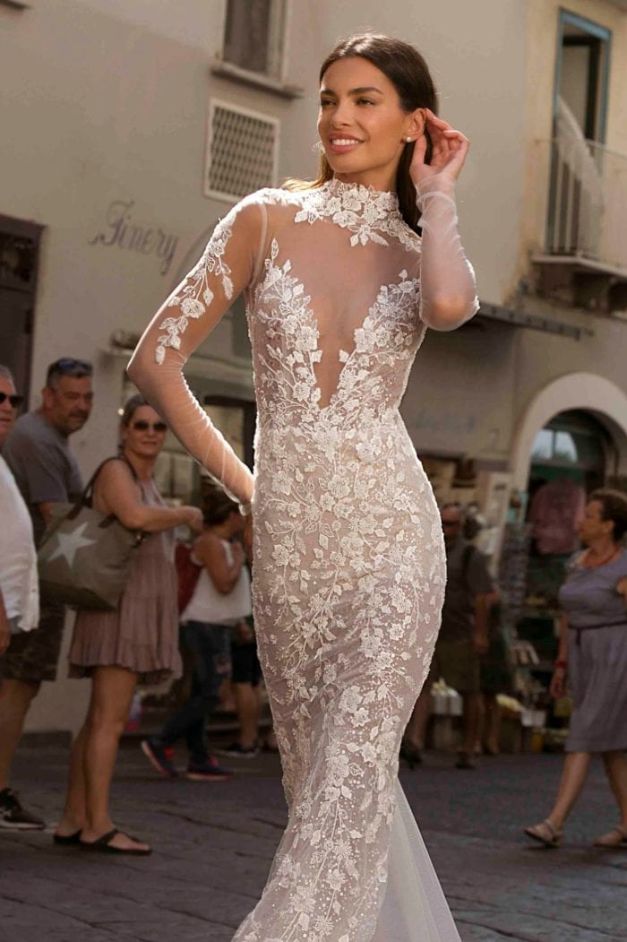 Sheer lace high neck designer bridal gown withlong sleeves