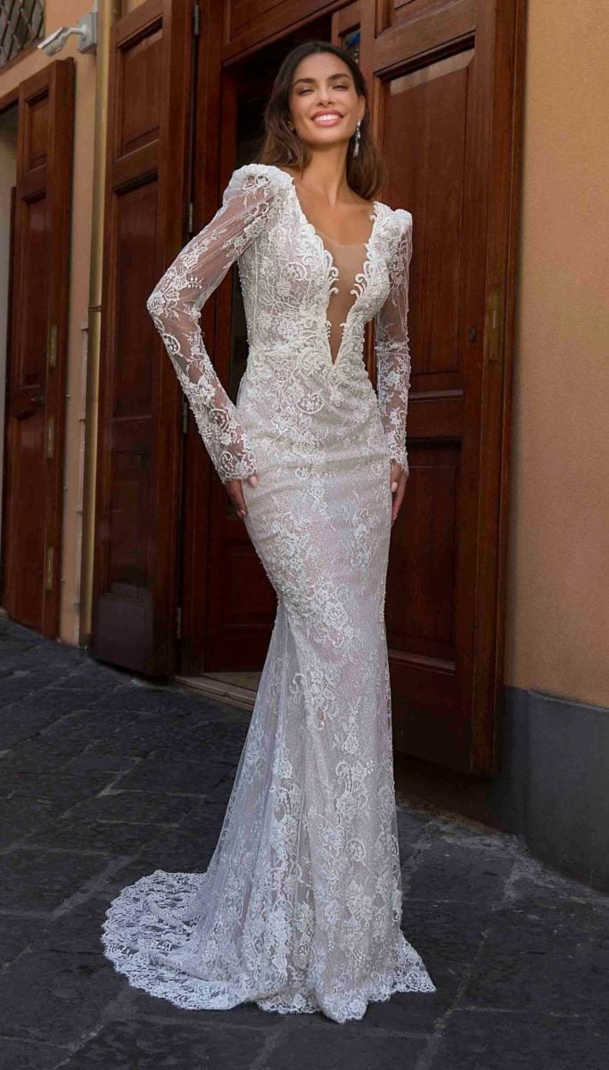 Long sleeve lace wedding dress with deep plunging neck