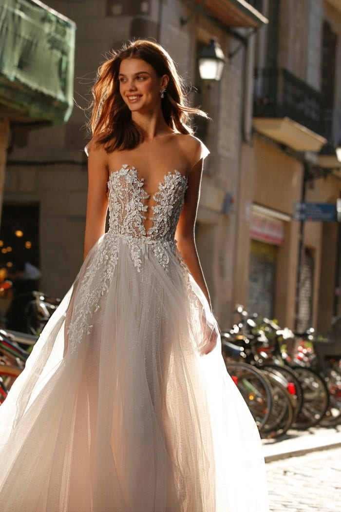 Sheer strapless bridal gown by Jolie Bridal gown