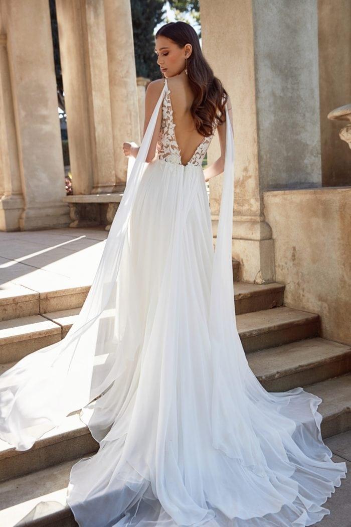 Wedding dress with shoulder streamers by Jenny Yoo