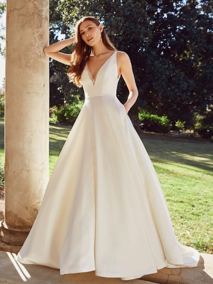 Modern ball gown wedding dress with V neck and pockets