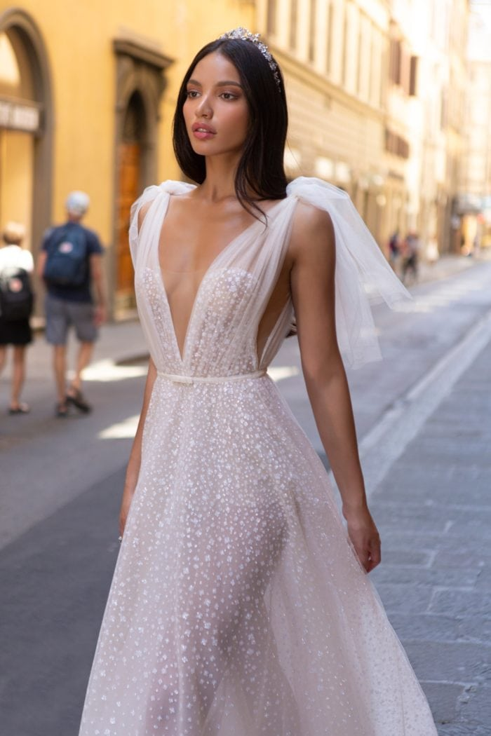 Sheer embellished beaded tulle bridal gown with deep luge neckline and shoulder ties