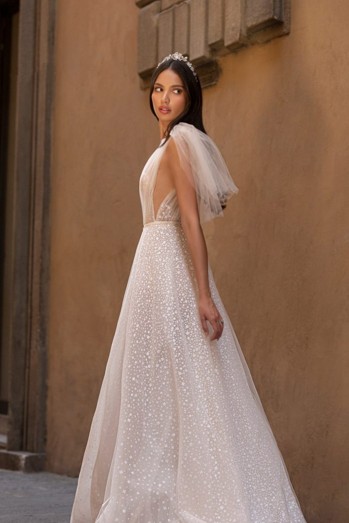 Sparkling tulle wedding dress with side cut outs and ties at shoulder