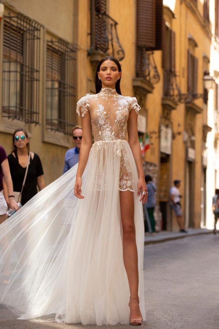 Sheer high neck short sleeve designer gown with overskirt