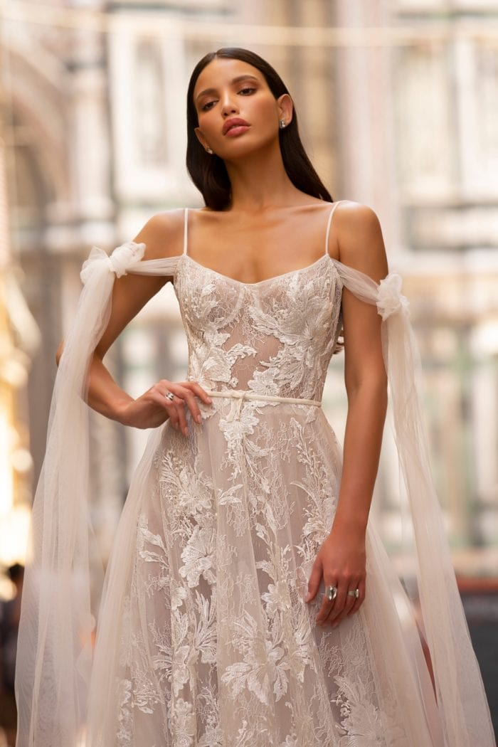 Romantic lace bridal gown with shoulder streamers