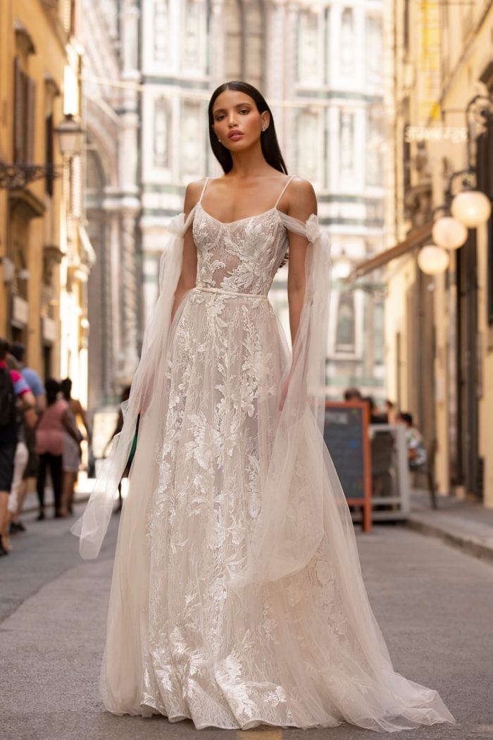 Lace and tulle designer wedding dress with long tulle shoulder streamers