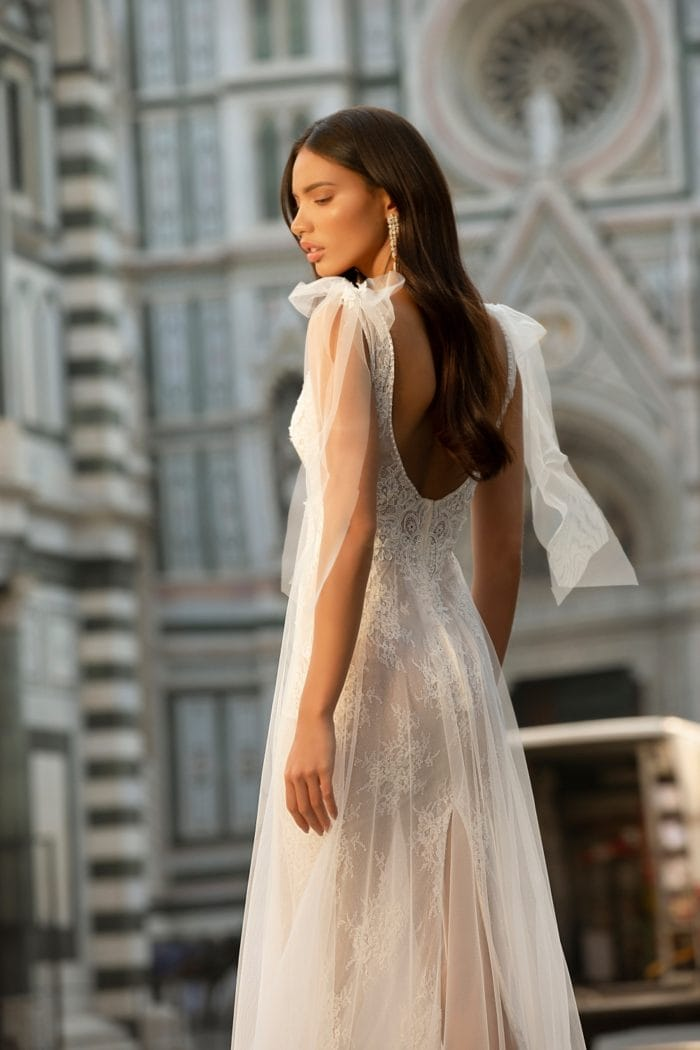 Muse by Berta Wedding Dress with tulle overlay and bows at shoulder
