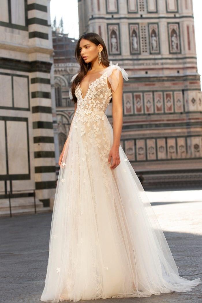 Tulle and floral detailed plunge neck designer wedding dress