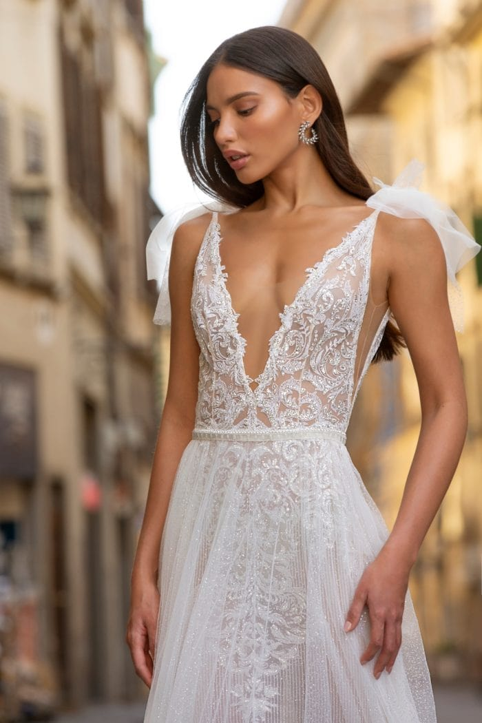 Beaded plunge neck couture designer wedding dress with tulle overskirt