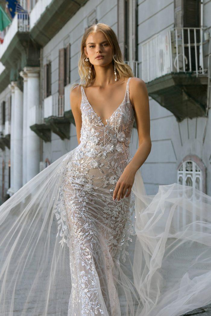 Floral beaded and embellished v neck overskirt bridal gown