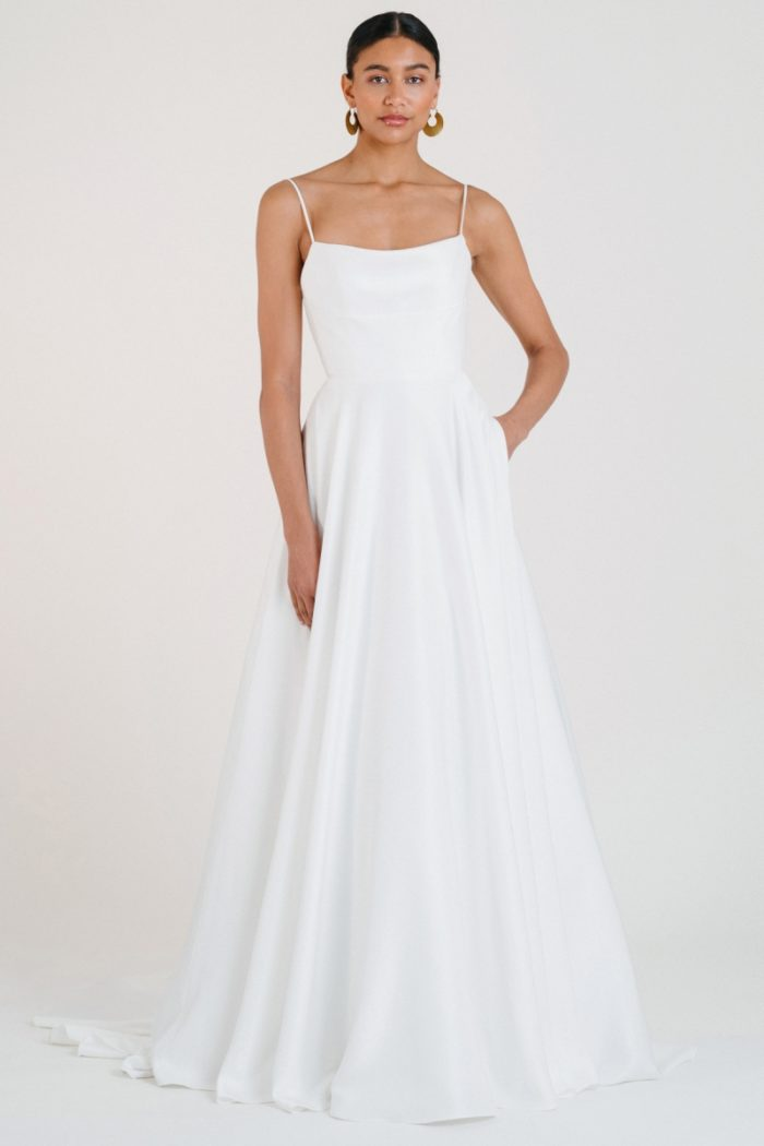 Ball gown wedding dress with spaghetti straps and pockets