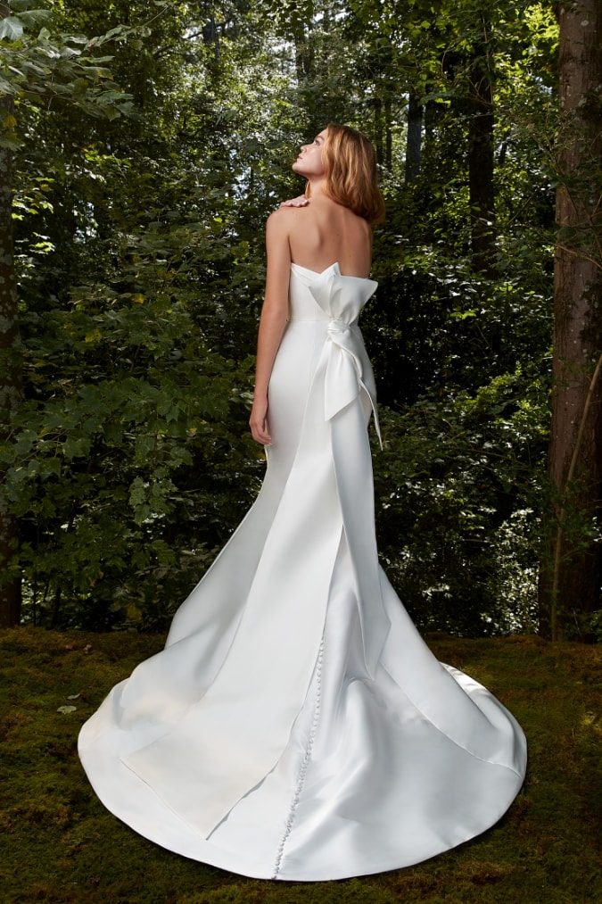 A bow back strapless wedding dress by Anne Barge