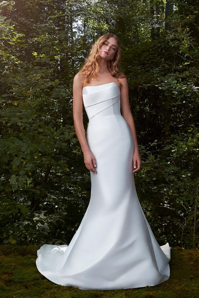 Modern strapless wedding dress with pleatd bodice and mermaid hem