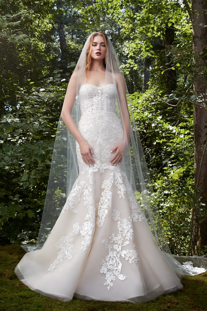 Mermaid wedding dress with floral applique and a strapless neckline