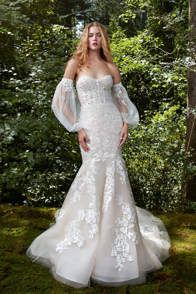 Strapless bridal gown with option of detachablepuff sleeves