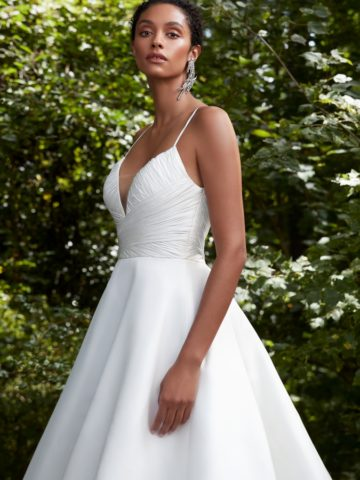 Spaghetti strap ballgown wedding dress with deep v neckline