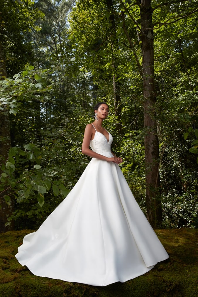 grand ballgown wedding dress with modern v neck bodice and spaghetti straps by Anne Barge