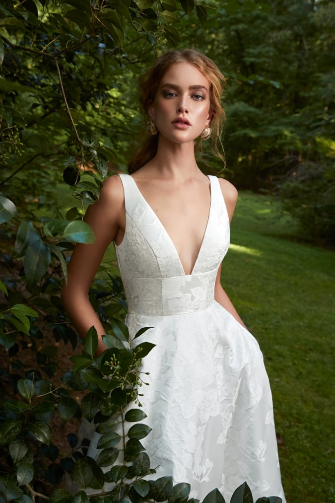 Wedding dress with pockets and and plunging square v neckine