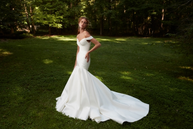 Dramatic off the shoulder bridal gown with mermaid fit and flare skirt