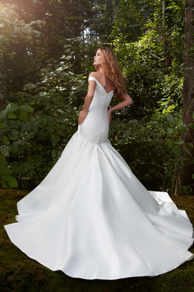 Off the shoulder wedding dress with fitted silhouette and flared meremaid hemline