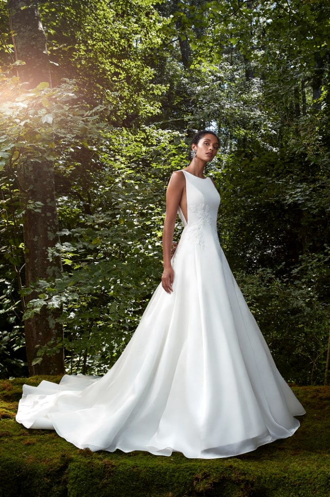 Ball gown wedding dress with boat neck bodice by Anne Barge