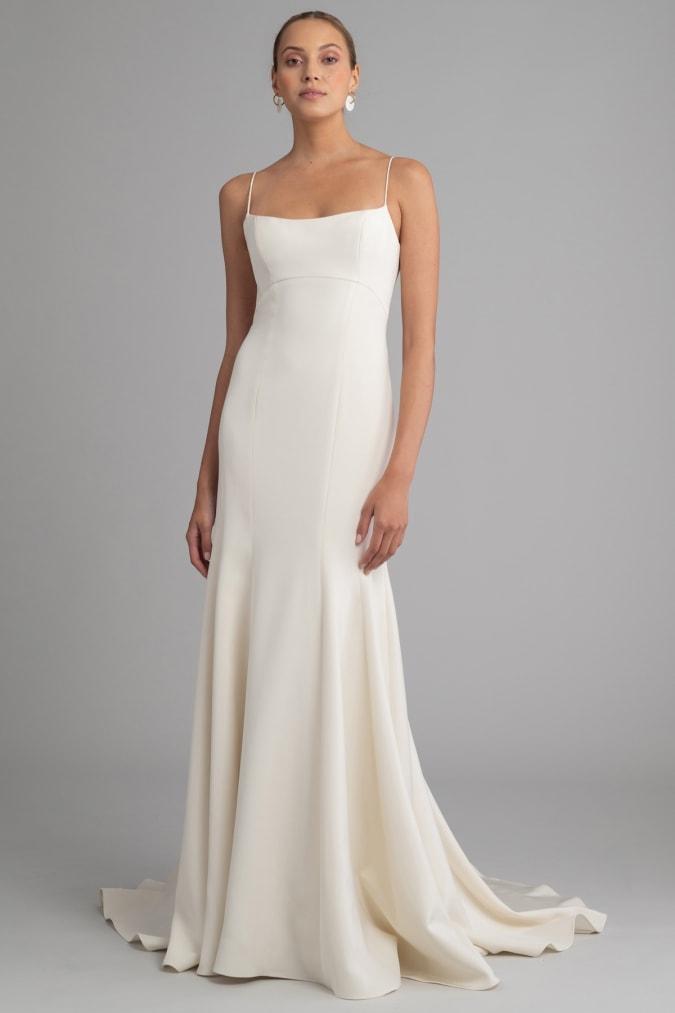 Modern minimalist ivory wedding gown with thin straps