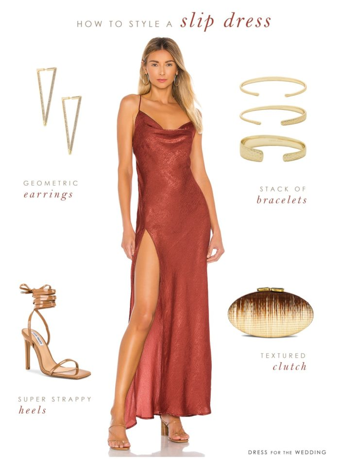 maxi length rust satin slip dress with gold accessories