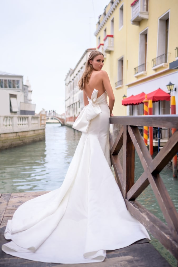 Strapless bridal gown with bow back