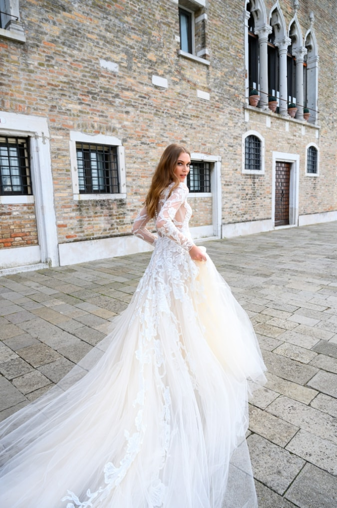 Long sleeve lace and tulletiered ballgown