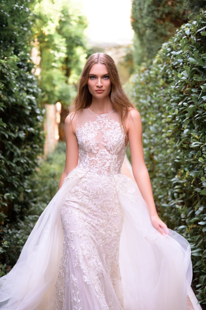 Embellished lace wedding dress with overskirt
