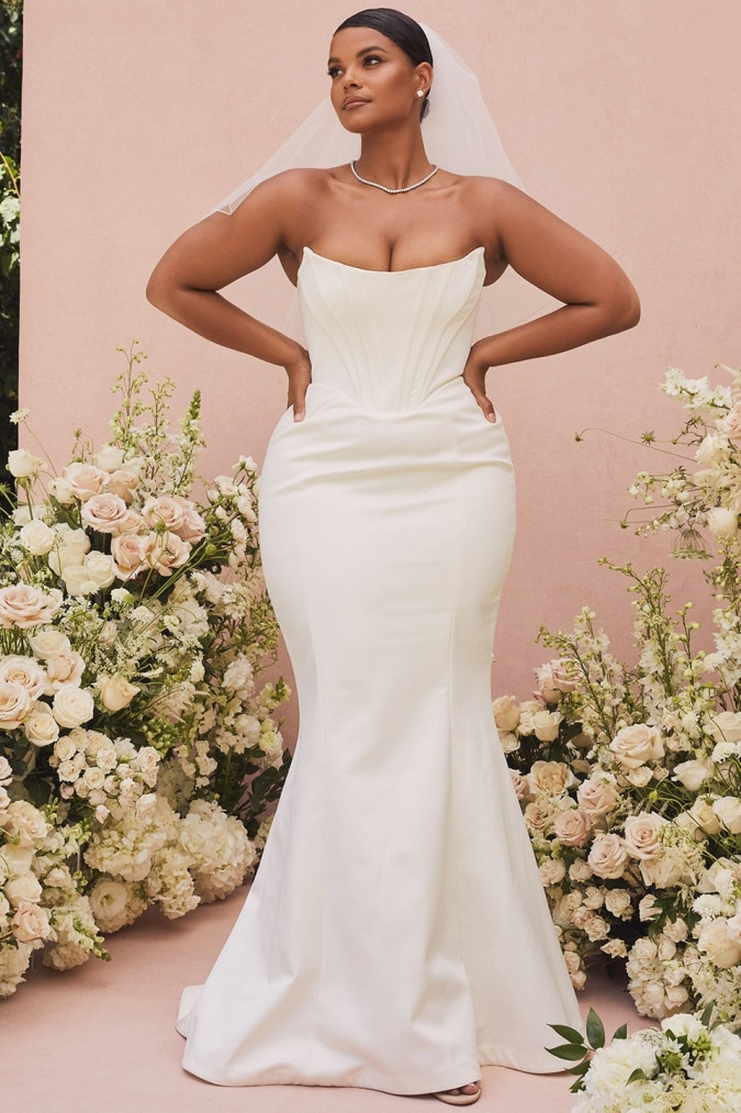 Plus size strapless wedding dress with corset and mermaid hem